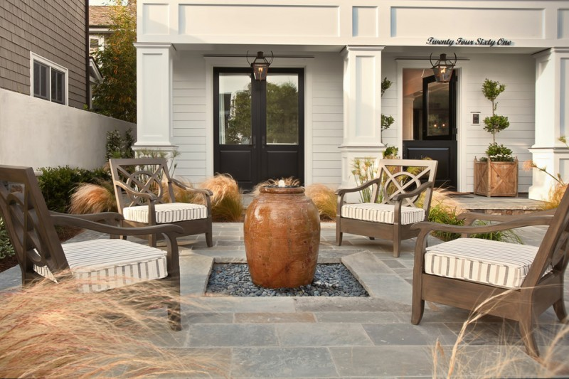 brown water fountain in the middle of patio sitting area