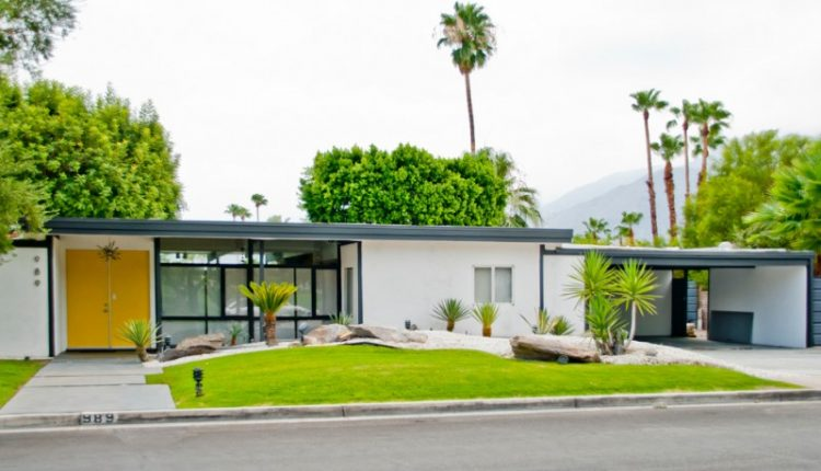 modern exterior home with white painted wall, large glass window, large yellow door, flat roof