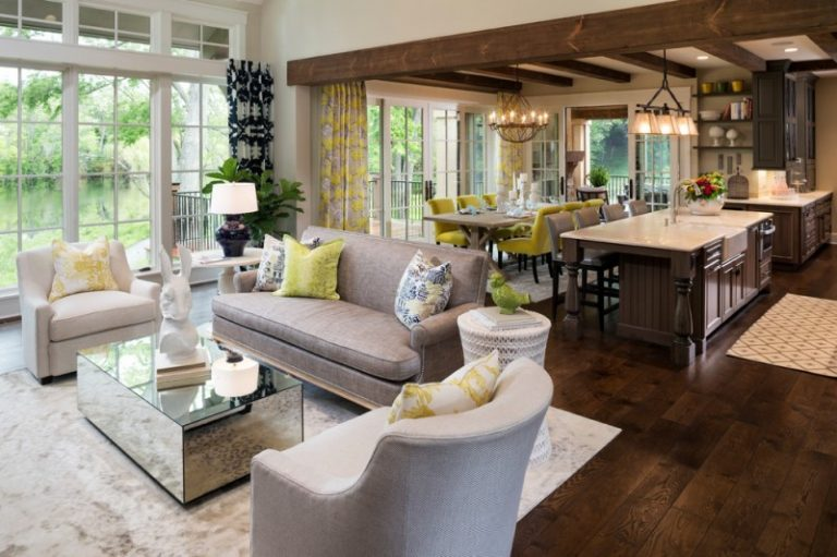 Open Living Room With Grey Sofa Set, Rectangular Mirrored Glass Surfaced Coffee  Table, Dining