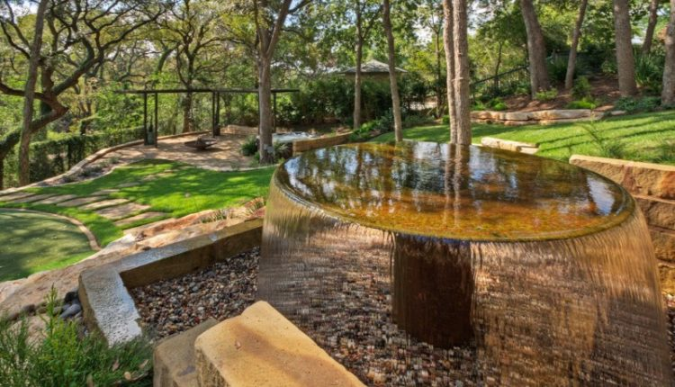 round copper flat water fountain with basin deep inside