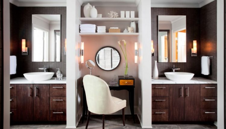 traditional bathroom with two separated white marble top vanity with white sinks, brown wooden cabinet, separated with shelves and makeup counter