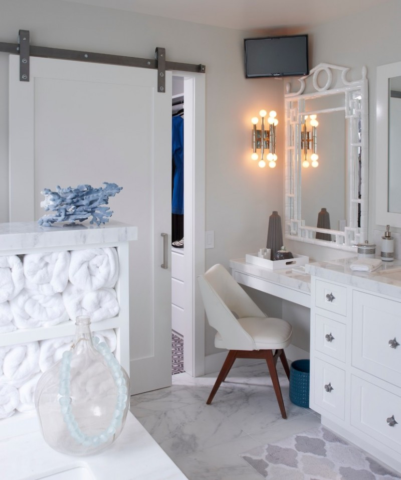 vanity with makeup counter with white marble top, white leather chair