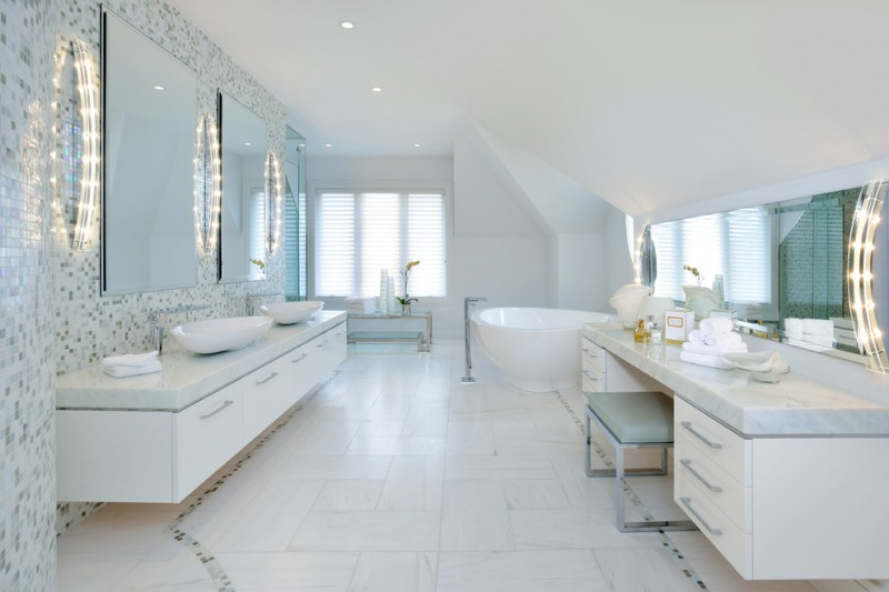 white marble top sink with long white wooden cabinet in front of white marble top make up vanity with white cabinet and mint stool with long large mirror with