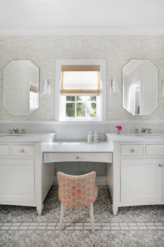 white marble top vanity with white wooden cabinet under, two white sinks and make up counter in the middle with flowery chairs'