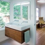 White Marble Trough Sink Placed On Top Of Wooden Cabinet With Double Faucet