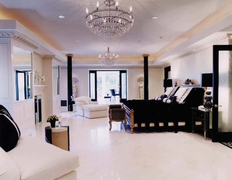 Contemporary master marble floor and white floor bedroom with chandelier lamp black columns white sofa black pillow throws black table lamps
