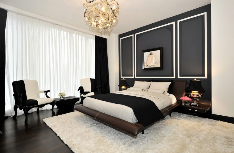 Large contemporary master dark wood floor bedroom with black walls chandelier lamp white rug black and white sofas black and white curtains
