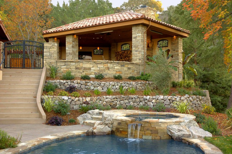hot tub water teature stacked stone planters pavilion paving staircase