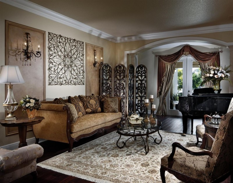 ornate living room with a music area and beige walls white table lamp brown sofas brown