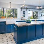 Tiled Backsplash Bay Window Blue Trim Blue Cabinet Floating Shelves Marble Countertope Kitchen Island Sink Tiled Floor