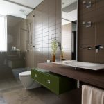 Brown Bathroom Brown Limestone Floor And Wall Tiles Dark Wood Countertop Floating Vanity Glass Shower Green Drawers Handheld Shower Head Large Bathroom Mirror