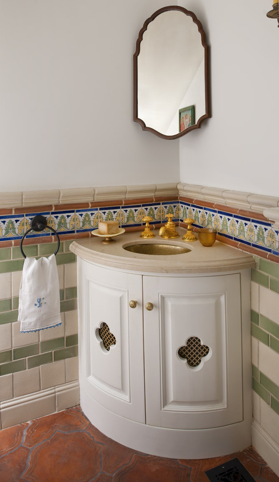 corner sink unique brown floor tile mediterranean powder room medium mirror with wood frame colorfull wall tiles gold faucet small storage towel ring