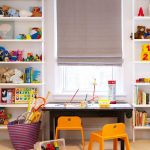 Kids Art Table Beige Carpet Bookshelves Gray Roman Shade Orange Chairs Toy Storage Basket Low Table With Storage Window