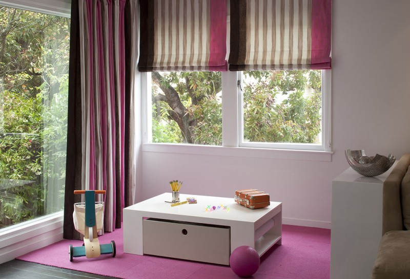 kids art table pink rug pink and brown roman shades striped curtain large glass windows unique kids art table with a big drawer