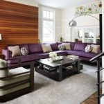 Purple Sofa Armchair Beadboard Black Coffee Table Floor Lamp Horizontal Wood Paneling Grey Rug Steel Railing Wood Floor Wooden Side Table Table Lamp