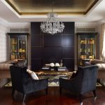 Black Accent Wall Artwork Beige Molding Beige Patterned Wallpaper Beige Sofa Beige Trim Black Accent Wall Black Armchairs Chandelier Wood Flooring