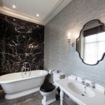 Black Accent Wall Bathroom Mirror Gray Wall Black Stone Wall Black Toilet Lid Recessed Lighting Antique Mirror Wall Sconces Sink Tub