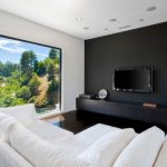 Black Accent Wall Built In Cabinets Floor To Ceiling Window Mannequin Statue Oversized Window Wall Mounted Tv White Sectional White Sofa White Wall