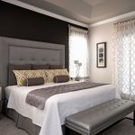 Black Accent Wall Grey Bed Grey Tufted Headboard Grey Bench Curtains Mirrored Nightstands Unique Table Lamps Yellow Pillows
