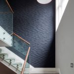 Black Accent Wall Textured Accent Wall Carpeted Stairs Drum Pendant Light Glass Stair Railing Natural Lighting Red Pendant Light
