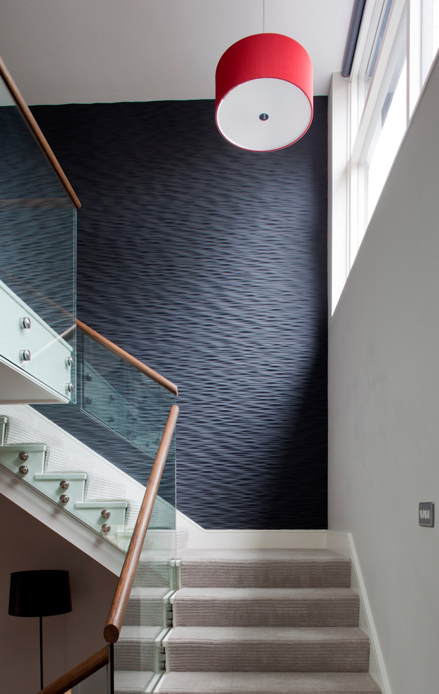 Black Accent Wall Textured Accent Wall Carpeted Stairs Drum Pendant Light  Glass Stair Railing Natural Lighting