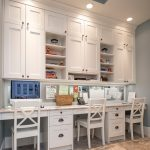 Craft Desk With Storage White Cabinet White Wooden Chairs Recessed Lighting Tray Ceiling Beige Floor Tile Metalic Backsplash
