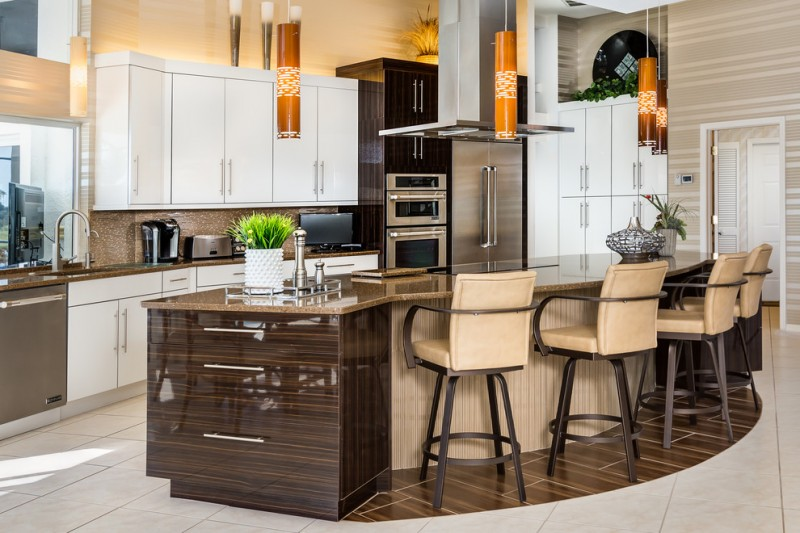 curved kitchen island beige bar stools brown backsplash brown backsplash electric stove top flat panel cabinets