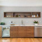 Floating Cabinet Open Cabinet Flat Panel Cabinet Medium Tone Wood Cabinet Built In Fridge Built In Wine Cooler Textured Backsplash In Cabinet Lighting Wood Cabinet