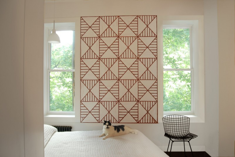 geometric wall art wall bedroom chair windows white pendant lamp white bedding red washi tape decoration