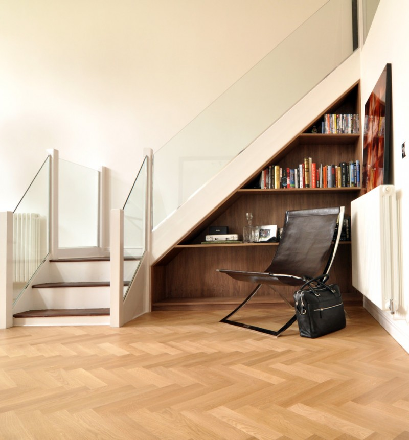 glass stair railing german oak floor herringbone floor leather chair bag book built in shelves under the stairs wall decor