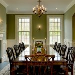 Green Dining Room Classic Wood Dining Table And Chairs Chandelir White Trim Wood Cabinet Fireplace Artwork Windows