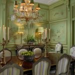 Green Dining Room Crystal Chandelier Dining Chairs And Table Gold Accents Candles Table Lamps Fruit Bowl