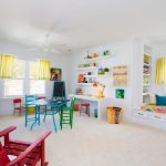 Kids Ceiling Fans Bench Seating Bicycle Rack Colorful Play Room Cube Shelving Colorful Chairs Built In Storage Yellow Curtains