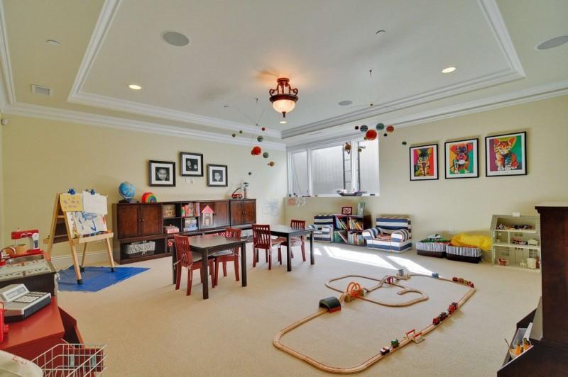 kids easel beige carpet beige ceiling beige wall book storage ceiling light dark wood dresser dark wood toy storage