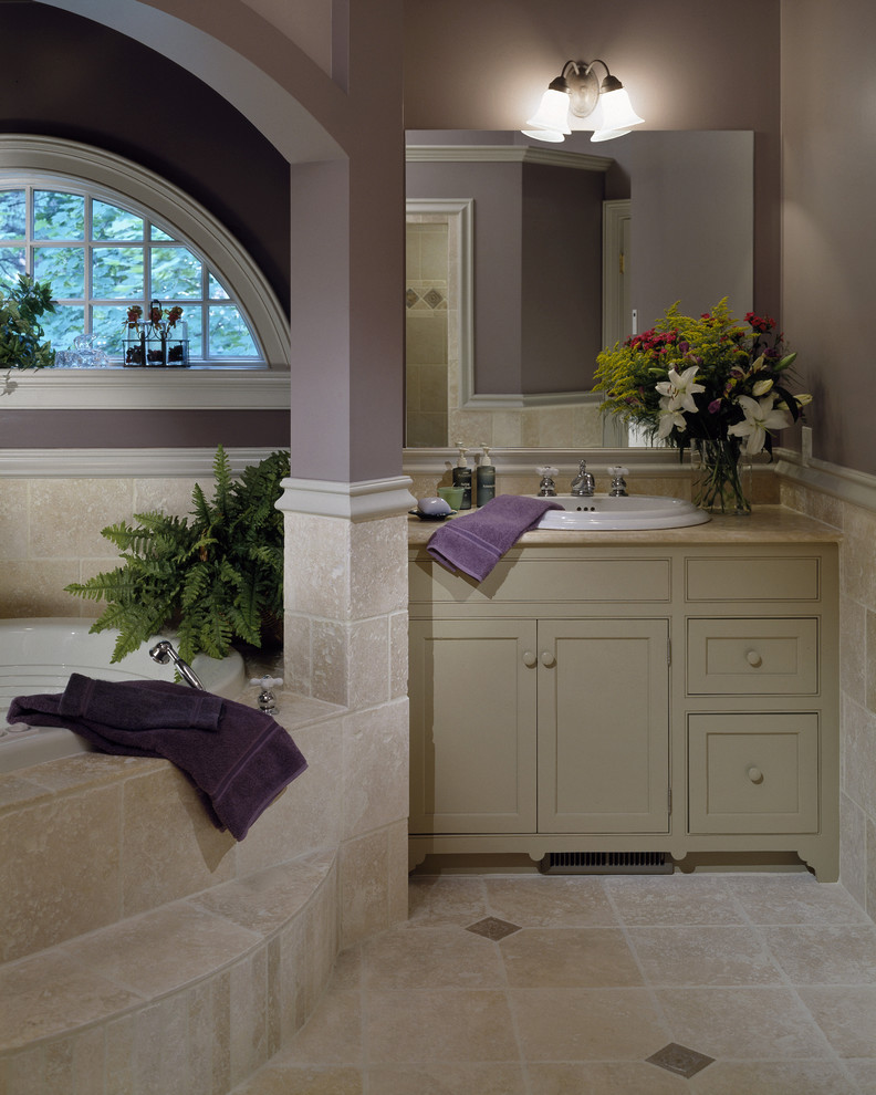 lavender bathroom arched window built in steps jacuzzi tub purple wall stone tiles tiled wall beige vanitu sink mirror