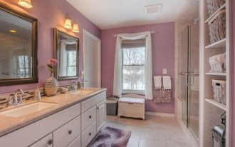 lavender bathroom window with roman shade and white curtains glass shower doors built in shelf flat vanity sink mirror sconces