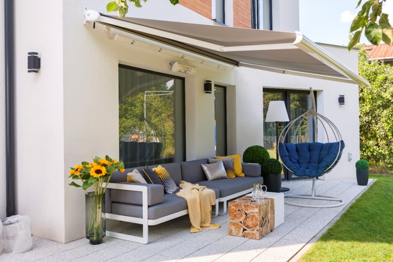modern awning container plants gray awning gray outdoor sofa hanging chair large flower vase wall sconces sliding glass door