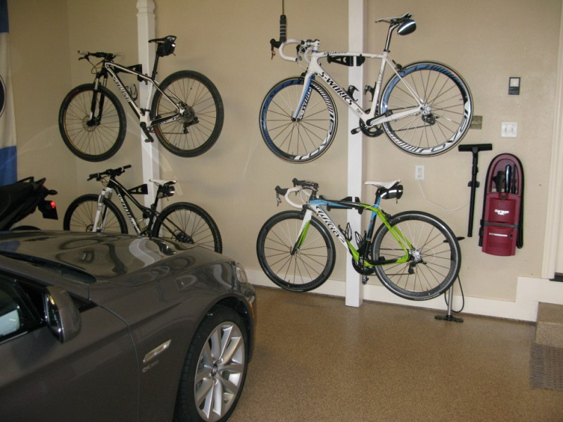 modern garage bike storage chips coatings epoxy floor coating hang rod hooks mount beige painted wall wall shelves