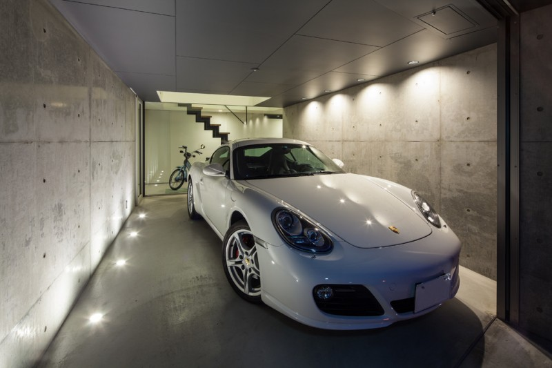 modern garage grey wall grey ceiling grey concrete floor glass door glass wall mini recessed lightings car motorcycle