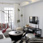 Moroccan Coffee Table Black And White Rug Black Candle Stands Black Media Console Drum Lampshade Gray Sectional Sofa Hanging Planters