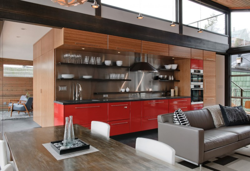 red cabinets area rug cedar clerestory windows concealed fridge concrete floating shelves flush cabinets grey sofa wooden dining table range hood