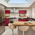 Red Cabinets Breakfast Bar Cream Leather Bar Stools Linear Natural Light Painted Kitchens Range Cooker Range Hood Wndows Glass Roofs Wooden Countertop