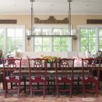 Red Chairs Large Colorful Rug Altar Chandelier Unique Wall Deco White Framed Windows Patterned Sofa Armchairs Wood Table