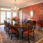 Red Dining Room Chandelier Patterned Wide Rug Dining Table And Chairs With Red Cushions White French Glass Doors And Windows Mirror