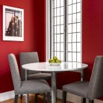 Red Dining Room Small Dining Room Windows White Trim Photograph Grey Chairs Area Rug Wood Floor Round White Dining Table