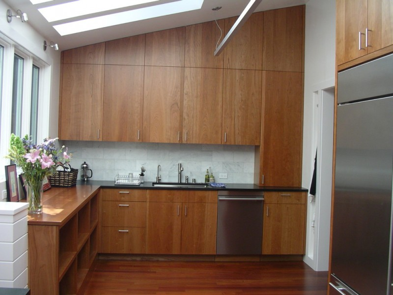 sloped ceiling cherry slab cabinet door glass windows glass ceiling sink drawers wood cubbies wooden floor basket