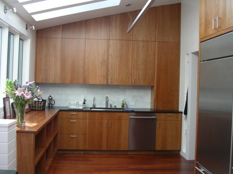 sloped ceiling cherry slab cabinet door glass windows glass ceiling sink drawers wood cubbies wooden floor basket