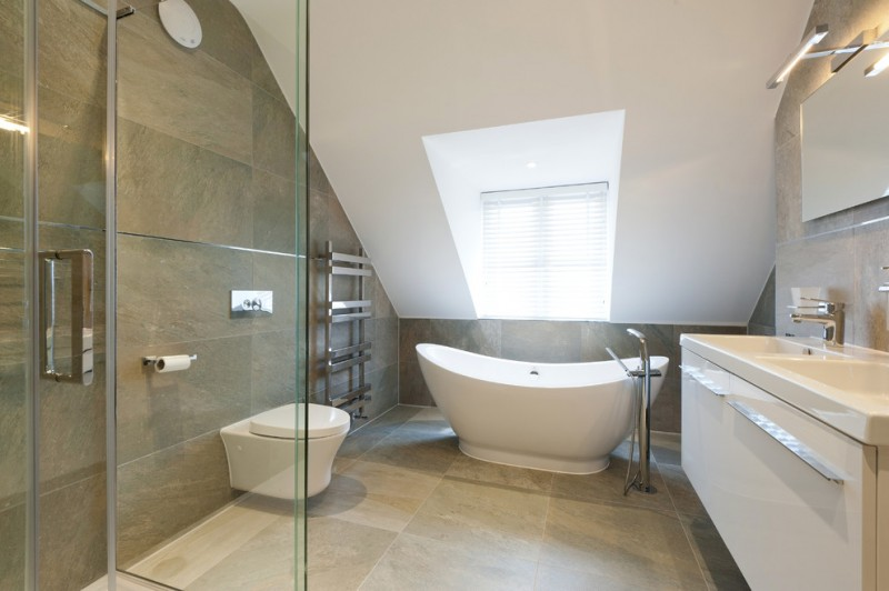 sloped ceiling tub floor mounted tub filler floor to ceiling tile ceiling window with blind mirror lighting undermount double sink