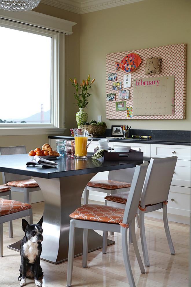square pedestal table stainles base black countertop calendar cornice board window dining chairs light hardwood flooring