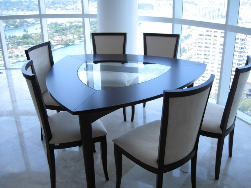 triangle dining table luxury coffee table and chairs glass and wooden triangular table beige cushion chairs windows granite floor